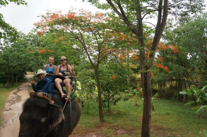 Jayme and Brittnay riding elephant